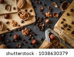 various nuts on stone table....   Shutterstock . vector #1038630379