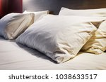 pillows on a large king size... | Shutterstock . vector #1038633517