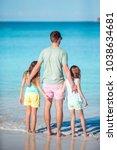 father and kids enjoying beach... | Shutterstock . vector #1038634681