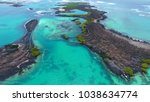 view of the ocean and the small ... | Shutterstock . vector #1038634774