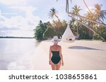 vacation on the seashore.young... | Shutterstock . vector #1038655861