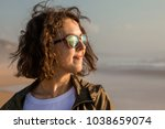 portrait of young and stylish... | Shutterstock . vector #1038659074