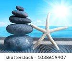 stack of zen pebble stones with ...   Shutterstock . vector #1038659407