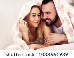 adult attractive couple in bed | Shutterstock . vector #1038661939