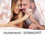 adult attractive couple in bed | Shutterstock . vector #1038661957