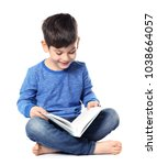 Cute Little Boy Reading Book O...