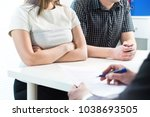 unhappy couple in meeting with... | Shutterstock . vector #1038693505