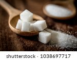 close up sugar cubes and cane... | Shutterstock . vector #1038697717