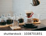 making pour over coffee with a... | Shutterstock . vector #1038701851