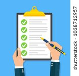 hand filling checklist on... | Shutterstock .eps vector #1038712957