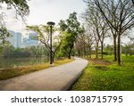 footpath in public park with...   Shutterstock . vector #1038715795