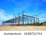 Construction site, steel frame structure is under construction - stock photo