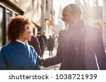 middle aged couple walking... | Shutterstock . vector #1038721939