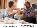 middle aged couple sitting... | Shutterstock . vector #1038727441