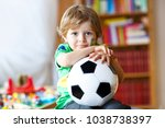 little blond preschool kid boy... | Shutterstock . vector #1038738397