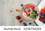 Stock photo cocktail bar background rose beverage with strawberry champagne ice and fresh berries against 1038744205