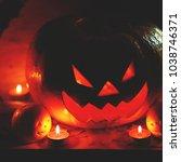 halloween pumpkin with scary... | Shutterstock . vector #1038746371