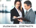 smiling female boss talking | Shutterstock . vector #1038746374