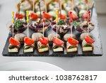 delicious catering snacks... | Shutterstock . vector #1038762817