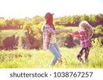 sister girls having fun in the... | Shutterstock . vector #1038767257