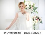 delicate happy blonde bride in... | Shutterstock . vector #1038768214