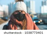 young woman wearing protective... | Shutterstock . vector #1038773401