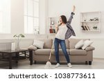 happy woman cleaning home ... | Shutterstock . vector #1038773611