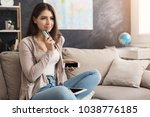 happy woman at home shopping... | Shutterstock . vector #1038776185