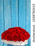 red roses flowers in a blue box ...   Shutterstock . vector #1038783415