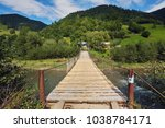 suspension bridge over river.... | Shutterstock . vector #1038784171