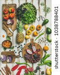 Small photo of Helathy vegan food cooking background. Flat-lay of Fresh fruit, vegetables, greens and superfoods on boards over white wooden table, top view, vertical composition. Clean eating, alkaline diet concept