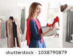 young woman shopping in... | Shutterstock . vector #1038790879
