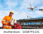 drone operated by construction... | Shutterstock . vector #1038791131