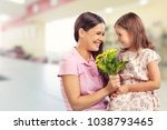happy child daughter and mother | Shutterstock . vector #1038793465