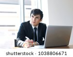 young businessman working in... | Shutterstock . vector #1038806671