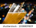motion of beer pouring from...   Shutterstock . vector #1038809809