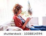 senior woman relaxing at home. | Shutterstock . vector #1038814594