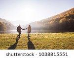 senior couple on a walk in an... | Shutterstock . vector #1038815551