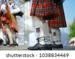 feet in scottish skirts  the... | Shutterstock . vector #1038834469
