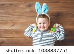 easter eggs in a child's hands. ... | Shutterstock . vector #1038837751