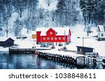 red wooden house on the banks... | Shutterstock . vector #1038848611