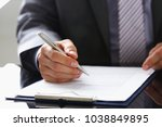 male arm in suit and tie fill... | Shutterstock . vector #1038849895