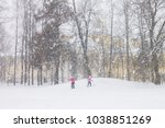 skiing in heavy snowfall day on ... | Shutterstock . vector #1038851269