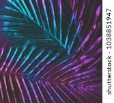 Small photo of Creative tropic purple leaves layout. Supernatural concept. Flat lay. Ultra violet colors.