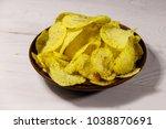 plate of potato chips on white... | Shutterstock . vector #1038870691