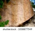 petroglyph rock man in wyoming | Shutterstock . vector #1038877549