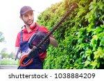 professional gardener dressed... | Shutterstock . vector #1038884209