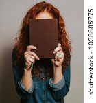 young woman with red curly hair ... | Shutterstock . vector #1038885775