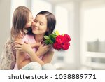 happy daughter and mother | Shutterstock . vector #1038889771