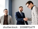 Small photo of Business people shaking hands finishing up a good deal